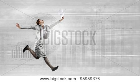 Young businesswoman in suit running at full pelt