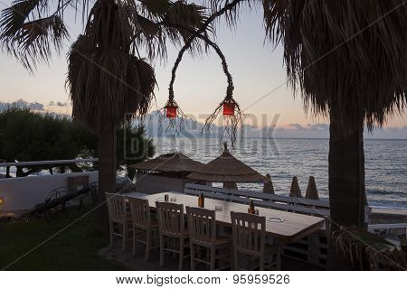 Lanterns on terrace by the sea