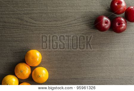 Clementines And Plums On Table
