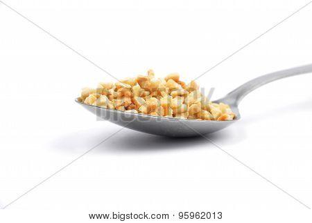Minced Hazelnuts On Spoon