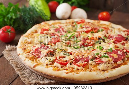 Pizza with salami, tomatoes and mushrooms