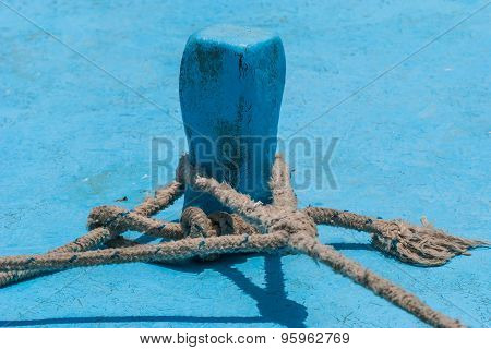 Old Wooden Fishing Boat Cleat With Rope Wrapped Around.