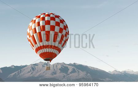 Businessman flying in search of ideas gripping the balloon