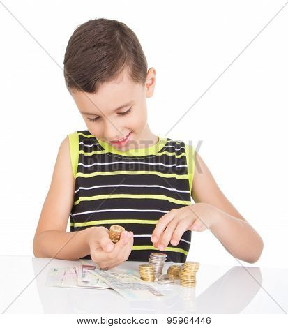 young boy counting his coins