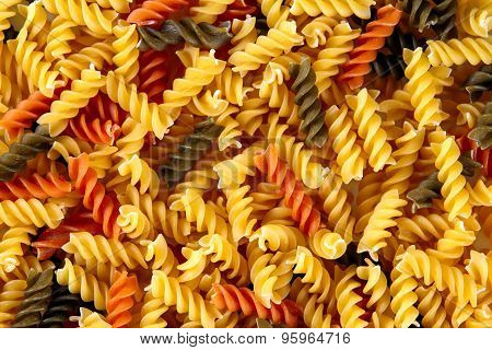 Traditional Italian Fusilli Tricocolore Close Up. Background, Texture