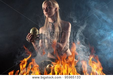 beautiful woman with a nest egg dragons in the fire