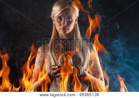 beautiful woman with a dragon egg in hands