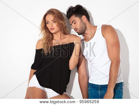 Sexy blonde woman looking away while her lover is looking down.