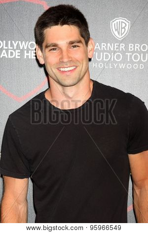 LOS ANGELES - JUL 14:  Justin Gaston at the Warner Bros. Studio Tour Hollywood Expansion Official Unveiling, Stage 48: Script To Screen at the Warner Brothers Studio on July 14, 2015 in Burbank, CA