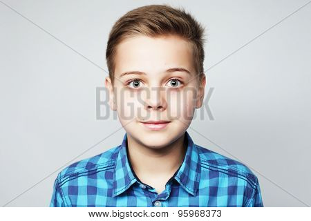 little boy in blue shirt over grey background