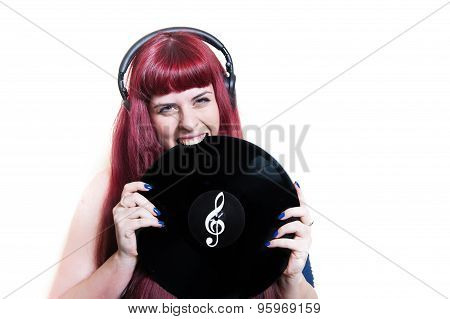 Young Pretty Woman With Headphones Biting Vinyl Disk