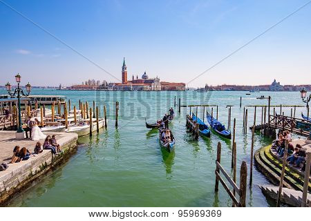 Gondola With The Tourist In Venice, Italy