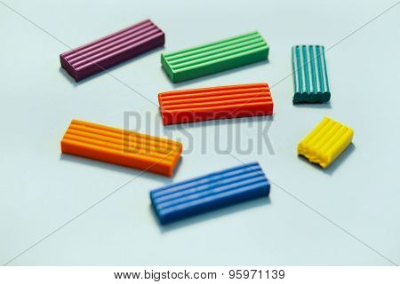 several sticks of colored plasticine