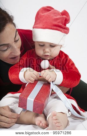 Baby Santa Claus With Mother Opening Red Gift