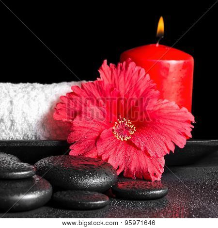 Beautiful Spa Concept Of Hibiscus Flower With Dew, Red Candles And White Rolled Towel Tied With Ribb