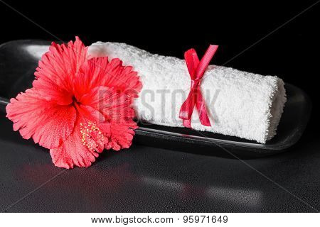 Beautiful Spa Concept Of Red Hibiscus Flower With Dew And White Rolled Towel Tied With A Ribbon, Clo