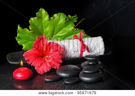Beautiful Spa Still Life Of Red Hibiscus Flower With Dew, Candles, Green Leaf, Scent Stick And Rolle