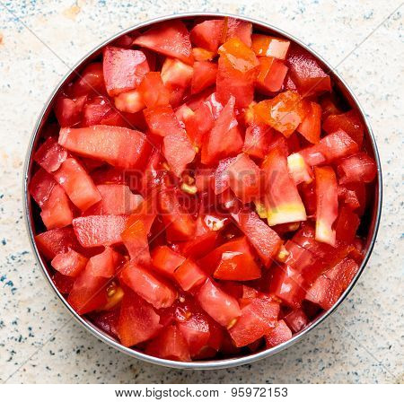 Macro image of finely chopped tomatoes kept in a vessel