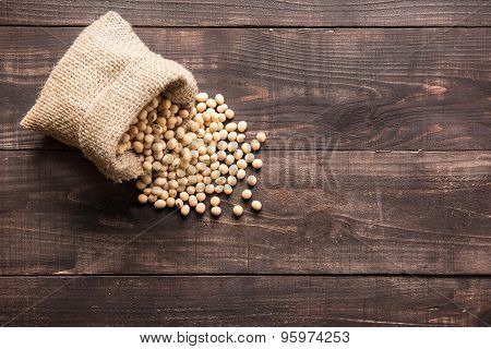 Top View Soybean On Wooden Background And Empty Space