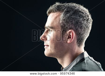 Profile view of a rugby player on a black background
