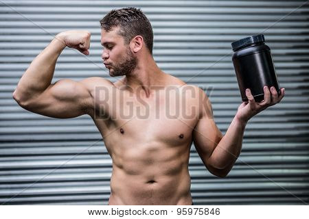 Muscular man posing in crossfit gym
