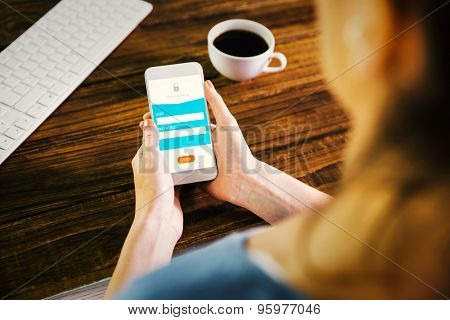 Woman using smartphone against online banking