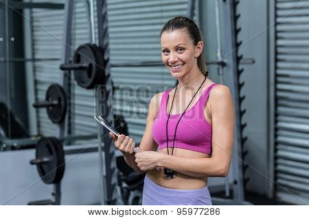 Portrait of a female coach with a clipboard and stopwatch