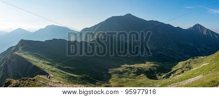 Panorama Of Amazing Morning Summer Mountains With Hikers