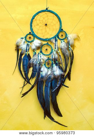 Dream catcher on old yellow  wall