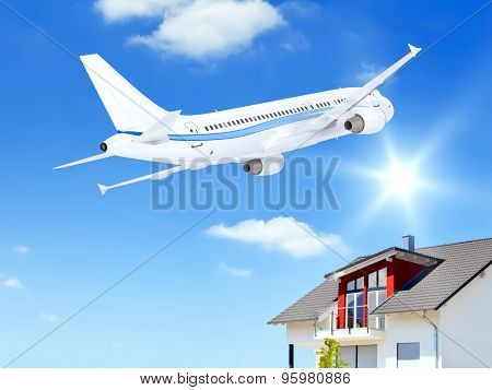 An image of an airplane over a private house