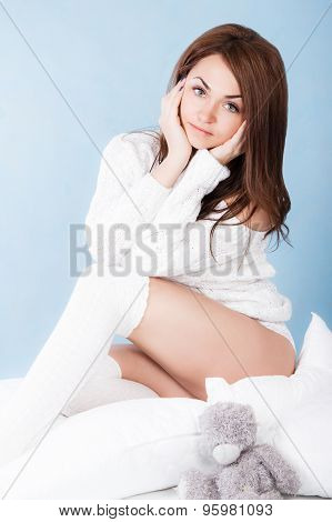Beautiful Young Woman In A Bed