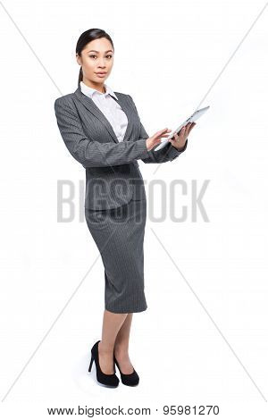 Poised Asian Woman Posing With Digital Tablet