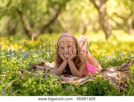 Young woman reading a book in the park.