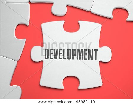 Development - Puzzle on the Place of Missing Pieces.