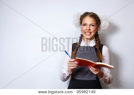 Excellent Student Holding A Notebook