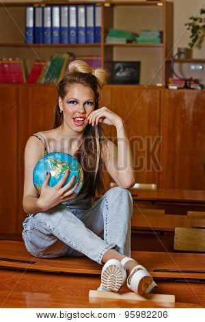 Wild Child In Geography Class With Globe.