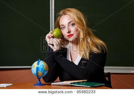 Geography Teacher Holding A Green Apple.
