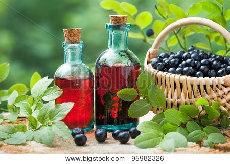 Two Vintage Bottles Of Tincture Or Cosmetic Product And Basket With Blueberries.