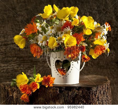beautiful bouquet of bright wildflowers lit by sunset light