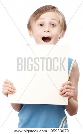 A blond boy holding a blank ad sign isolated on a white background