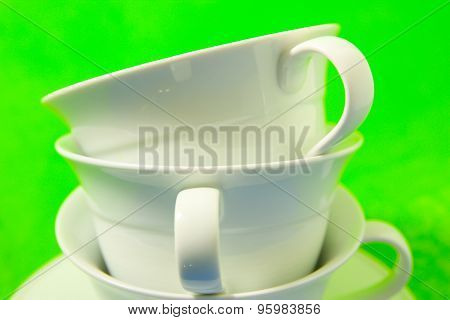 White Cups On A Green Background