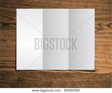 clear trifold template on wood texture background