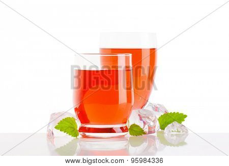 Two glasses of red fruit flavored drinks