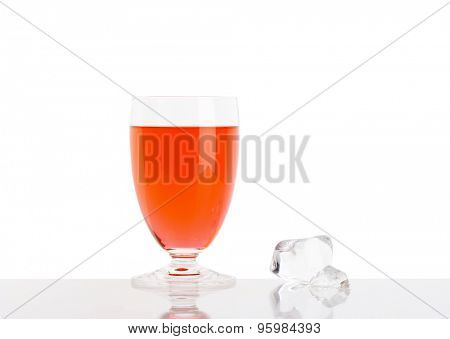 Glass of fresh red juice on white background