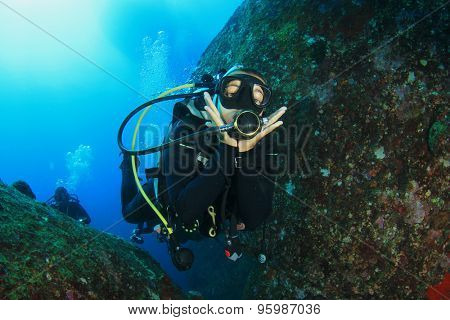 Female scuba diver having fun