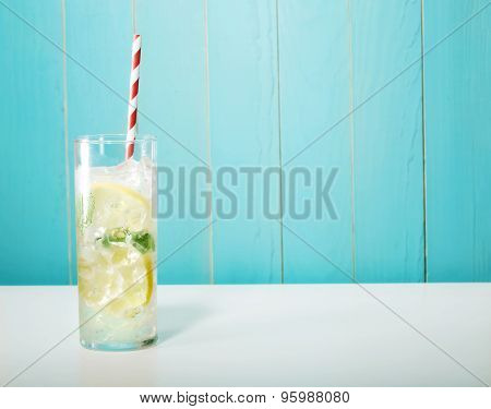 Iced Lemonade With Big Red Striped Straws