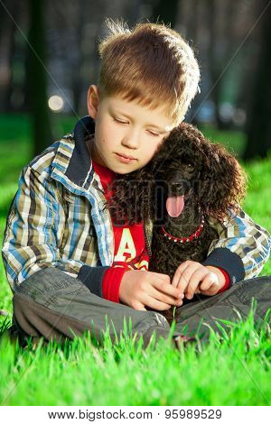 The boy with poodle