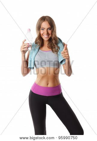 Pretty Woman Holding A Bottle Of Water After Workout