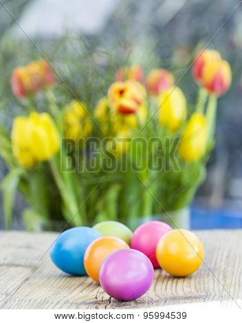 Group Of Colorful Easter Eggs On A Rustic Table