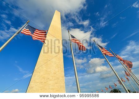 Washington Monument and waving United States flags rounding, Washington DC United States